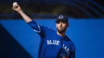 Toronto Blue Jays starting pitcher Marco Estrada throws a bullpen session during baseball spring training in Dunedin, Fla., on Friday, February 17, 2017. THE CANADIAN PRESS/Nathan Denette