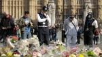 Attacker Khalid Masood is believed to have used the messaging service WhatsApp before running down pedestrians on Westminster Bridge and storming a gate outside Parliament armed with two knives on Wednesday. Four died in the rampage, including a police officer. (Matt Dunham/AP Photo)