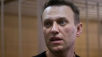 Russian opposition leader Alexei Navalny speaks in court in Moscow, Russia, Monday, March 27, 2017. (AP Photo/Denis Tyrin)