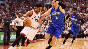 Toronto Raptors guard DeMar DeRozan (10) drives past Orlando Magic centre Nikola Vucevic (9) during first half NBA basketball action, in Toronto on Monday, March 27, 2017. THE CANADIAN PRESS/Frank Gunn