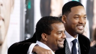 """FILE - In this Dec. 16, 2008, file photo, Will Smith, right, and Alfonso Ribeiro pose together at the premiere of """"Seven Pounds"""" in Los Angeles. Ribeiro posted a picture of himself with Smith and their """"Fresh Prince of Bel Air"""" cast mates on Instagram March 27, 2017. (AP Photo/Matt Sayles, File)"""