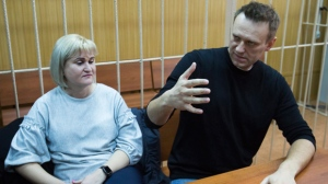 Russian opposition leader Alexei Navalny, right, gestures while speaking, as his lawyer Olga Mikhailova listens, in court in Moscow, Russia, Monday, March 27, 2017. Navalny, who organized a wave of nationwide protests against government corruption that rattled authorities, was fined 20,000 rubles ($340) on Monday by a Moscow court. It was a comparatively lenient punishment for organizing an unsanctioned rally for which he faced up to 15 days in jail. The court has yet to deliver its ruling on charges accusing the opposition leader of resisting arrest. (AP Photo/Denis Tyrin)