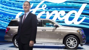 Ford Canada President Mark Buzzell poses in front of the 2017 Ford Expedition during the Canadian International Autoshow in Toronto on Thursday, February 16, 2017. THE CANADIAN PRESS/Mark Blinch