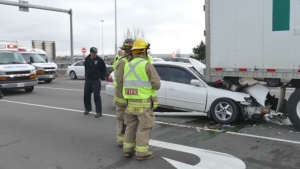Firefighters are pictured at the scene of a serious collision at Highway 410 and Steeles Avenue in Brampton Tuesday March 28, 2017. (Pascal Marchand /CP24)
