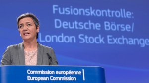 "European Commissioner for Competition Margrethe Vestager speaks during a media conference at EU headquarters in Brussels on Wednesday, March 29, 2017. The European Union blocked the proposed merger of Germany's Deutsche Boerse and the London Stock Exchange on Wednesday, saying that it had ""very serious"" concerns about the deal's impact on competition. (AP Photo/Virginia Mayo)"