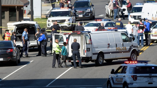 A woman, centre, is taken into custody on Capitol Hill in Washington on Wednesday. Police say a driver struck a U.S. Capitol Police cruiser near the U.S. Capitol and was taken into custody. (Susan Walsh/AP Photo)