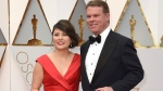 This Feb. 26, 2017 file photo shows Martha L. Ruiz, left, and Brian Cullinan from PricewaterhouseCoopers at the Oscars in Los Angeles.  Film academy president Cheryl Boone Isaacs says the two accountants responsible for the best picture mistake will not work the Oscars again. Cullinan and Ruiz were responsible for the winners' envelopes at Sunday's Oscar show. Cullinan tweeted a photo of Emma Stone from backstage minutes before handing presenters Warren Beatty and Faye Dunaway the wrong envelope for best picture. Boone Isaacs said Cullinan's distraction caused the error. 