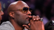 In this March 30, 2016, file photo, former Los Angeles Lakers' player Lamar Odom watches during the second half of an NBA basketball game between the Lakers and the Miami Heat in Los Angeles. (AP Photo/Mark J. Terrill, File)