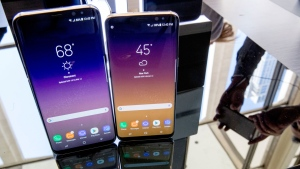 The Samsung Galaxy S8, right, and S8 Plus appear on display after a news conference, Wednesday, March 29, 2017, in New York. The Galaxy S8 features a larger display than its predecessor, the Galaxy S7, and sports a voice assistant intended to rival Siri and Google Assistant. (AP Photo/Mary Altaffer)