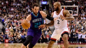 Charlotte Hornets guard Marco Belinelli (21) drives to the net past Toronto Raptors forward PJ Tucker (2) during second half NBA basketball action, in Toronto on Wednesday, March 29, 2017. THE CANADIAN PRESS/Frank Gunn