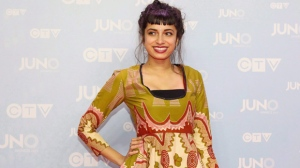 Alysha Brilla poses on the red carpet during the 2015 Juno Awards in Hamilton, Ont., on Sunday, March 15, 2015. THE CANADIAN PRESS/Peter Power