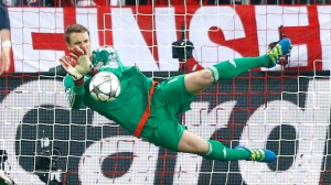 "In this May 3, 2016 file photo, Bayern goalkeeper Manuel Neuer saves an Atletico's Fernando Torres penalty during the Champions League second leg semifinal soccer match between Bayern Munich and Atletico de Madrid in Munich, Germany. Bayern Munich will have to do without goalkeeper Manuel Neuer for two games because of a foot injury. The Bundesliga leaders say the 31-year-old Germany goalkeeper injured his left foot in training on Wednesday March 29, 2017. Club doctor Markus Walther performed a small operation and the club says it ""went optimally."" (AP Photo/Matthias Schrader,file)"