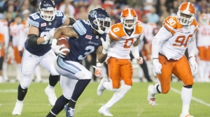 Toronto Argonauts running back Brandon Whitaker carries the ball forward during first half CFL football action against the BC Lions, in Toronto on Wednesday, August 31, 2016. The Toronto Argonauts have re-signed star running back Brandon Whitaker. Whitaker was named an East Division all-star last season after racking up 1,009 yards and three touchdowns on 189 carries, becoming the 41st player in CFL history to rush for 5,000 career yards in the process. THE CANADIAN PRESS/ Chris Young