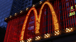 This Sunday, Jan. 10, 2016, photo shows the sign at the McDonald's restaurant on 42nd Street near Times Square in New York.  (AP Photo/Gene J. Puskar