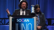 Paul Langlois and Rob Baker of The Tragically Hip accept the Rock Album of the Year at the Juno Gala awards show in Ottawa, Saturday April 1, 2017. THE CANADIAN PRESS/Sean Kilpatrick