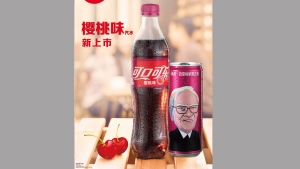 This undated image provided by The Coca-Cola Co. shows an ad for Coke products, including a can of Cherry Coke with a likeness of billionaire investor Warren Buffett, in China. Coke said it introduced Cherry Coke in China on March 10, 2017, and that the special edition cans with Buffett's image will remain on shelves for a limited time. Buffett is a known fan of Cherry Coke, and his Berkshire Hathaway is Coke's largest single shareholder. (The Coca-Cola Co. via AP)