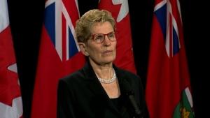 Premier Kathleen Wynne speaks to reporters on April 4, 2017.