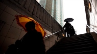 Pedestrians shield themselves from rain under an umbrella in downtown Toronto Friday, March 4, 2011. Environment Canada issued a special weather statement on Friday morning, warning that Toronto city can expect to get drenched by up to 40mm of rain this weekend. THE CANADIAN PRESS/Darren Calabrese