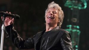 FILE - In this Friday, March 31, 2017, file photo, Jon Bon Jovi of the band Bon Jovi performs in concert during their 'This House Is Not for Sale Tour' at The Wells Fargo Center in Philadelphia. (Photo by Owen Sweeney/Invision/AP, File)