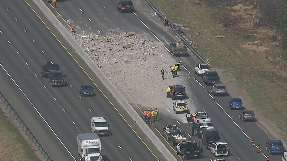 Truck carrying cement blocks flips over on Hwy  400 | CP24 com