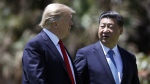 In this April 7, 2017 file photo, U.S. President Donald Trump, left, and Chinese President Xi Jinping walk together after their meetings at Mar-a-Lago, in Palm Beach, Fla. (AP / Alex Brandon, File)