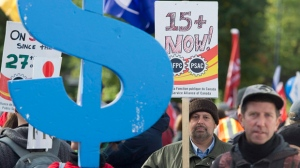 People gather in Montreal, Saturday, October 15, 2016, to demand a $15 minimum hourly working wage in the province of Quebec and across Canada. THE CANADIAN PRESS/Graham Hughes