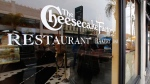 The Cheesecake Factory restaurant logo is seen in this file photo. (AP Photo Damian Dovarganes)