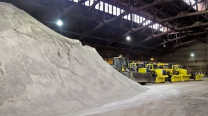 "Snowplows sit idle next to a stockpile of road salt inside the streets department garage Buffalo, N.Y., Friday, Dec. 4, 2015. The city had yet to see its first measurable snowfall Friday, breaking the old record for latest first snow set on Dec. 3, 1899. Last year some areas of the city and suburbs saw 7 feet of snow in November during what's now called the ""Snowvember"" storm. (AP Photo/Carolyn Thompson)"