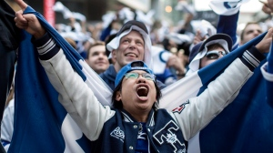 Toronto Maple Leafs fans watch their team's first play off game against Washington Capitals on a giant screen in Toronto's Maple Leaf Square. (Chris Young/The Canadian Press)