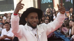 Tory Lanez arrives on the red carpet for the 2015 Much Music Video Awards in Toronto on June 21, 2015. THE CANADIAN PRESS/Nathan Denette