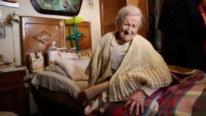 In this Tuesday, Nov. 29, 2016 file photo, Emma Morano sits in her home on the day of her 117th birthday in Verbania, Italy.  (AP Photo/Antonio Calanni, File)