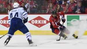 Washington Capitals left wing Alex Ovechkin (8) handles the puck in front of Toronto Maple Leafs defenseman Morgan Rielly (44) during the second period in Game 1 of an NHL Stanley Cup first round playoff series in Washington, Thursday, April 13, 2017. (AP Photo/Molly Riley)