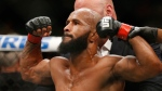 In this Sept. 5, 2015, file photo, Demetrious Johnson celebrates after defeating John Dodson in a flyweight title mixed martial arts bout at UFC 191 in Las Vegas. (AP Photo/John Locher, File)