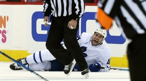 oronto Maple Leafs defenseman Roman Polak (46), of the Czech Republic, lies on the ice after being injured during the second period of Game 2 against the Washington Capitals in an NHL Stanley Cup first-round playoff series in Washington, Saturday, April 15, 2017. (AP Photo/Molly Riley)