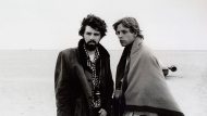 """In this March 1976 publicity photo released by Lucasfilm Ltd. & TM, director, George Lucas, and actor, Mark Hamill, who portrays young Luke Skywalker, are shown on the salt flats of Tunisia during principal photography of the original """"Star Wars.""""  Lucas has selected Chicago to house his much anticipated museum of art and movie memorabilia, a spokesman for the mayor's office said Tuesday, June 24, 2014. Bill McCaffrey, a spokesman for Mayor Rahm Emanuel, confirmed that Lucas had selected Chicago but did not immediately have any details. (AP Photo/Lucasfilm Ltd. & TM, file)"""