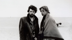 "In this March 1976 publicity photo released by Lucasfilm Ltd. & TM, director, George Lucas, and actor, Mark Hamill, who portrays young Luke Skywalker, are shown on the salt flats of Tunisia during principal photography of the original ""Star Wars.""  Lucas has selected Chicago to house his much anticipated museum of art and movie memorabilia, a spokesman for the mayor's office said Tuesday, June 24, 2014. Bill McCaffrey, a spokesman for Mayor Rahm Emanuel, confirmed that Lucas had selected Chicago but did not immediately have any details. (AP Photo/Lucasfilm Ltd. & TM, file)"