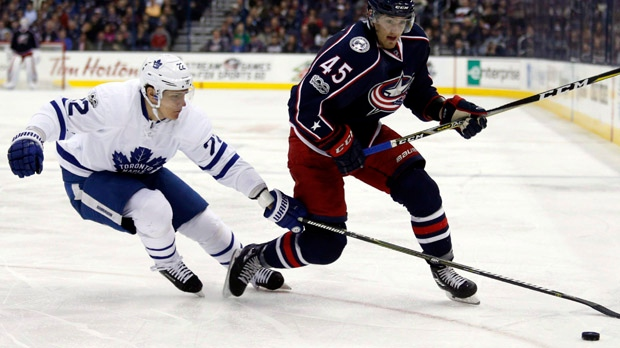Toronto Maple Leafs defenceman Nikita Zaitsev, left, knocks the puck away from Columbus Blue Jackets forward Lukas Sedlak during the second period of an NHL hockey game in Columbus, Ohio, Wednesday, March 22, 2017. Zaitsev will become the 10th Leaf to make his playoff debut this spring, ready to rejoin the team for Game 3 on Monday night after sitting out the opening two games of a first round series against Washington with a suspected concussion.THE CANADIAN PRESS/AP/Paul Vernon