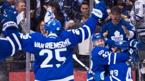 Toronto Maple Leafs centre Tyler Bozak (42) celebrates his game winning goal with Maple Leafs centre Nazem Kadri (43) and Maple Leafs left wing James van Riemsdyk (25) against the Washington Capitals during overtime NHL hockey round one playoff action in Toronto on Monday, April 17, 2017. THE CANADIAN PRESS/Nathan Denette
