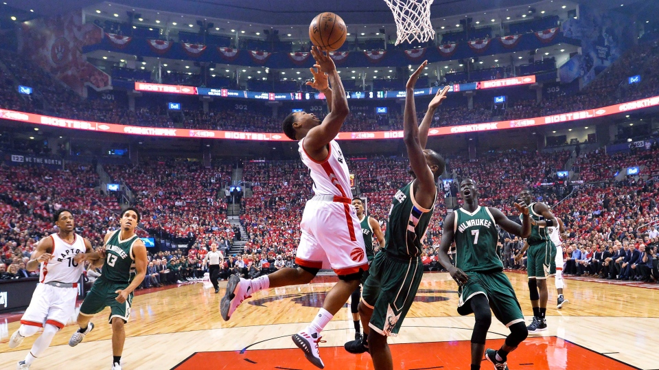 Toronto Raptors guard Kyle Lowry (7) drives past Milwaukee Bucks guard Khris Middleton (22) during first half NBA round one playoff basketball action in Toronto on Tuesday. (Nathan Denette/The Canadian Press)