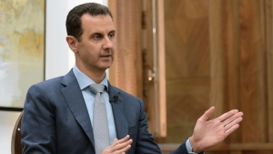 In this Feb. 10, 2017 file photo released by the Syrian official news agency SANA, Syrian President Bashar Assad speaks during an interview with Yahoo News in Damascus, Syria. (SANA via AP, File)
