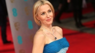 Actor Gillian Anderson poses for photographers on the red carpet at the EE British Academy Film Awards held at the Royal Opera House on Sunday Feb. 16, 2014, in London. (Photo by Joel Ryan/Invision/AP)