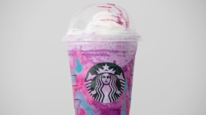 "A Starbucks Unicorn Frappuccino drink sits on display, Thursday, April 20, 2017, in Philadelphia. Starbucks' entry into the unicorn food craze was released Wednesday and its popularity was too much for Colorado barista Braden Burson. He posted a video on Twitter complaining that the drink was difficult to make and he's ""never been so stressed out"" in his life. (AP Photo/Matt Rourke)"