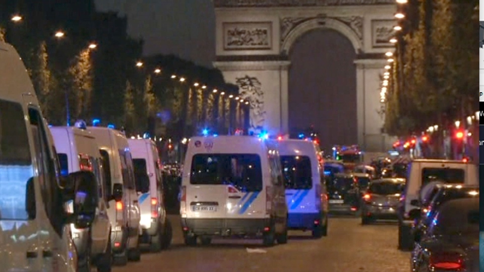 This image made from AP video shows police attending an incident on the Champs Elysees in Paris in which a police officer was killed along with an attacker in a shooting, Thursday April 20, 2017. (AP Photo)
