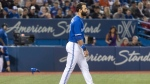 Toronto Blue Jays' Jose Bautista walks away from home plate after striking out against the Boston Red Sox in the third inning of their MLB American League baseball game in Toronto on Thursday. (Fred Thornhill/The Canadian Press)