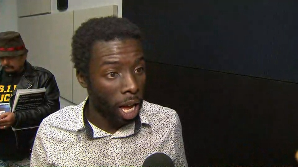 Activist Desmond Cole is seen outside the Toronto Police Services Board meeting discussing his stance on carding with reporters on April 20, 2017.