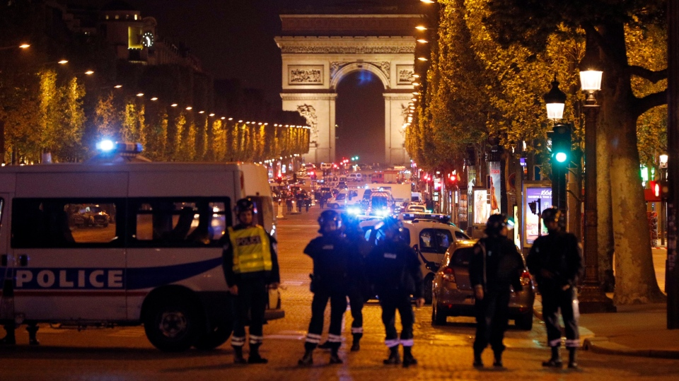 Police seal off the Champs Elysees avenue in Paris, France, after a fatal shooting in which a police officer was killed along with an attacker on Thursday. (Kamil Zihnioglu/AP Photo)