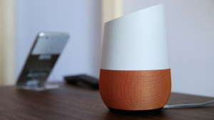 In this Tuesday, Oct. 4, 2016, file photo, Google Home, right, sits on display near a Pixel phone following a product event, in San Francisco. (AP Photo/Eric Risberg, File)