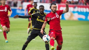 Columbus Crew SC Mohammed Saeid gets tangled up with Toronto FC Mo Babouli second half MLS soccer action in Toronto Saturday May 21, 2016. THE CANADIAN PRESS/Aaron Vincent Elkaim