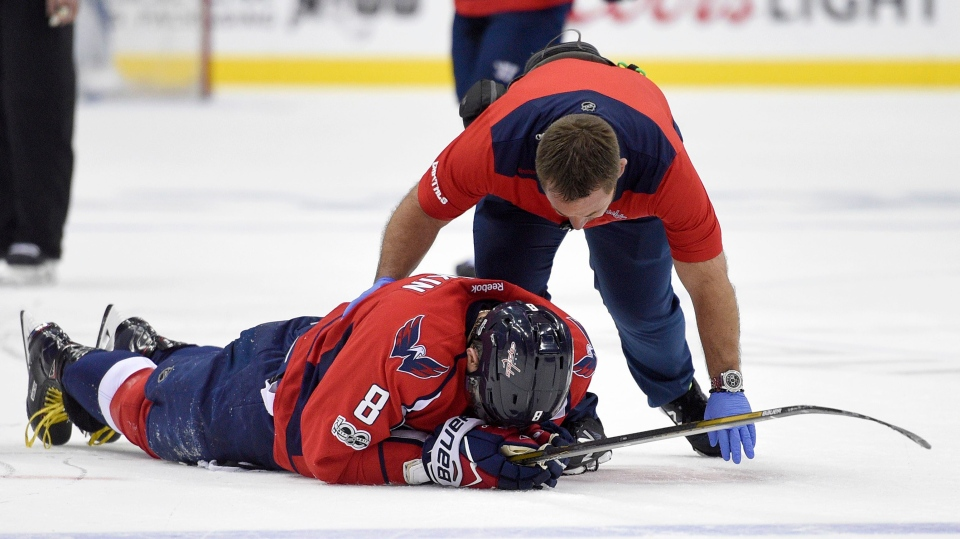 Washington Capitals left wing Alex Ovechkin (8), of Russia, is tended to by a trainer after he was injured during the first period of Game 5 in an NHL Stanley Cup hockey first-round playoff series against the Toronto Maple Leafs. (Nick Wass/AP Photo)