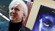 """In this Jan. 28, 2010, file photo, film director James Cameron poses for photos prior to the opening of the movie """"Avatar"""" in Davos, Switzerland. Cameron says the long-awaited sequel to his science-fiction epic will not be released in 2018. (AP Photo/Virginia Mayo, File)"""